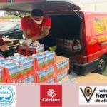 Veteranos HERCULES CF repartien alimentos Caritas